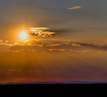 Primordial Sunset over Taos by njordphoto