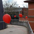 Red balloons showing the way by Mick Kupresanin