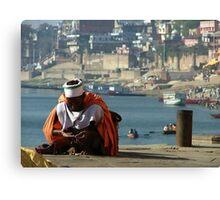 Saddhu Sits by the Ganges Canvas Print