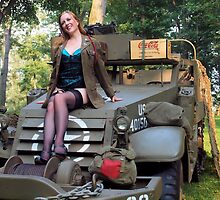 A redhead pinup on a WWII White Halftrack by LibertyCalendar