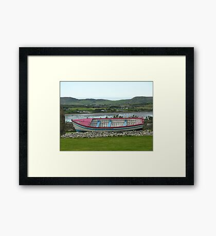 A Retired Boat Beside The Water Framed Print