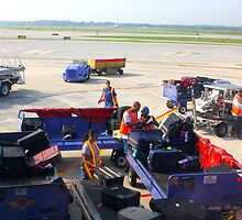 Airport Baggage Loading Scene By Jonathan Green by Jonathan  Green