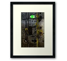 concrete wall with an illuminated escape route and emergency switch Framed Print