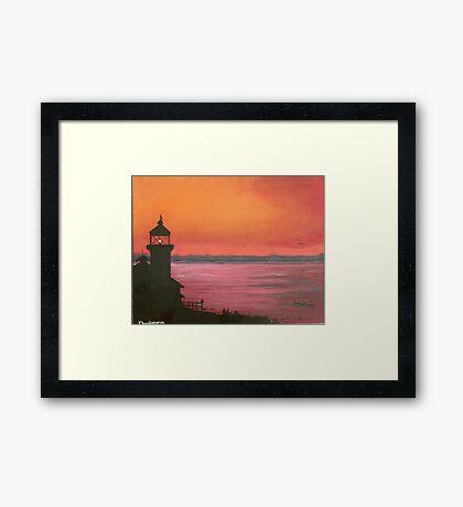 lighthouse at sunset Framed Print