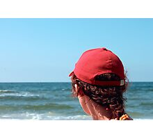 A woman in a red cap Photographic Print