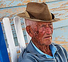 Old Cuban man in rocking chair, Vinales, Cuba by buttonpresser