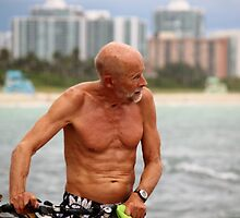 Old Man, his Bike and the Sea by Rene  Triay