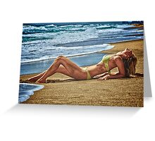 Blond girl sun tanning lazing at the beach. Greeting Card