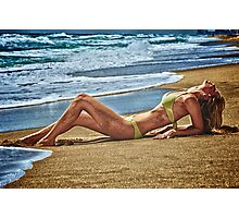 Blond girl sun tanning lazing at the beach. Photographic Print