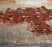 Stone wall of the old brick and plaster by vladromensky