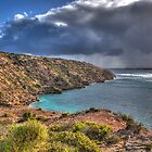 Sun showers off Cape Finnis Head by Simon Bannatyne