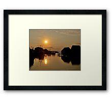 Golden Piers Framed Print