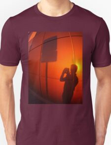 The shadow of a man on a red-orange wall T-Shirt