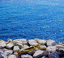 Yellow Canoe on Rocks by Hollyis