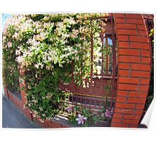 Facade of the building with a brick wall with flowers Poster