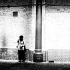 Boy waiting by wall by markheathcote