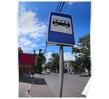 Road sign with a picture of a bus stop on a city street Poster