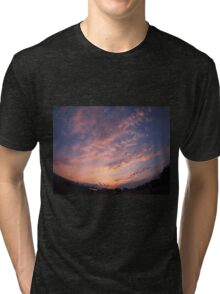 Skies and clouds over the city at sunset Tri-blend T-Shirt