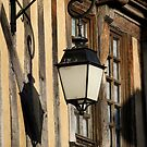 Street Light On A Medieval House - France by Samantha Higgs