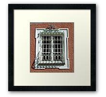 Wrought iron window. Framed Print