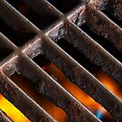 Crusty Iron Grill with Flames Beneath by Kenneth Keifer