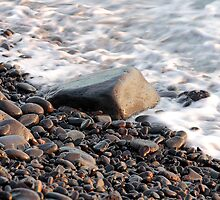 Stony shore by Phil  Crean