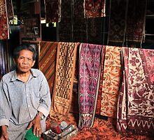 local man from tenganan selling ikat textiles, bali by nicole makarenco