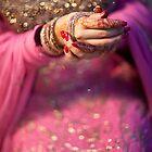 Putting on Bangles by naureen bokhari