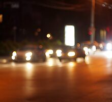 Defocused cars, the lights from the headlights by vladromensky