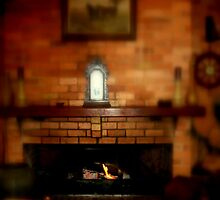 Keeping warm in front of a open Fireplace by Chris Chalk