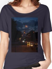 Cars with headlights on driving on city road Women's Relaxed Fit T-Shirt