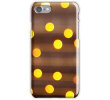 Defocused and blur image of yellow round light bulb iPhone Case/Skin