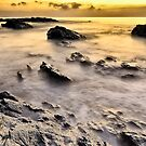 sunrise in a rock beach by ser-y-star