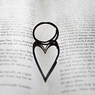 Heart shadow with rings on a book by Nasko .