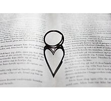 Heart shadow with rings on a book Photographic Print