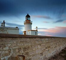 Chanonry point lighthouse at dusk.  by John Ellis