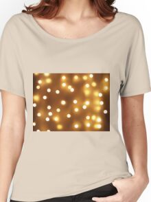 Blur image of yellow round light bulb Women's Relaxed Fit T-Shirt