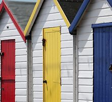 Colourful wooden English beach huts by Tony Steel