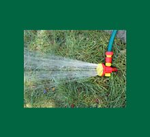 Hose with a spray watering the lawn closeup Unisex T-Shirt