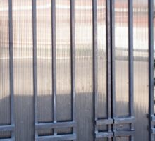 Locked gates with ornaments of metal strips Sticker