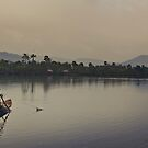 Fishing on Kampot River, Cambodia  by Anthony and Kelly Rae