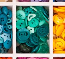 multicolor buttons  for handicrafts in box isolated on white Sticker