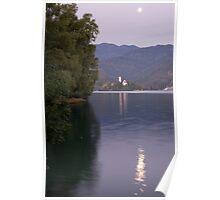 Moon setting at sunrise over Island church at Lake Bled Poster