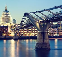 St. Paul`s Cathedral and Millennium Bridge by fineartphoto1