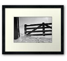 Fence in snow landscape Framed Print