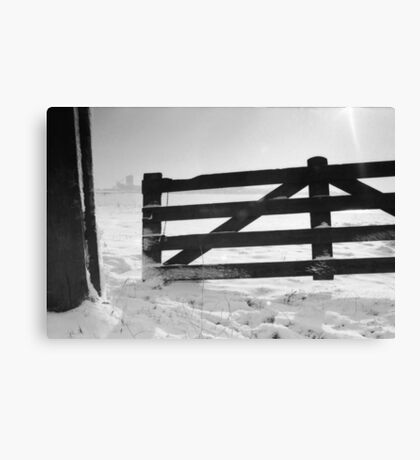 Fence in snow landscape Canvas Print