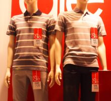 Two male mannequin in a showcase Sticker