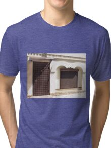 The facade of a small house Tri-blend T-Shirt
