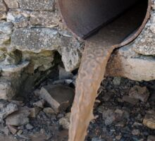 Dirty water flows from a brown rusty sewer pipes Sticker