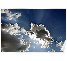 Sunlight through clouds in bright blue sky Poster